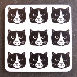 black and white cat heads coaster