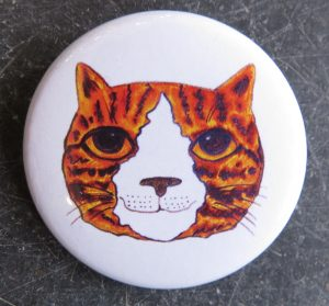 lapel pin, lapel badge, badges, ginger cat, jane adams, pawprint designs