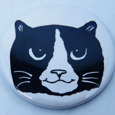 round fridge magnet black and white cat