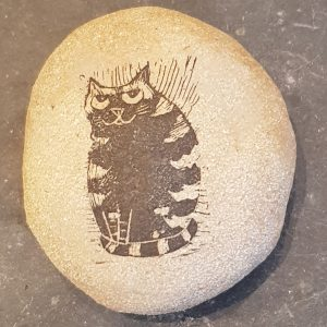 handmade, clay pebble, stoneware, paperweight, stripey cat design